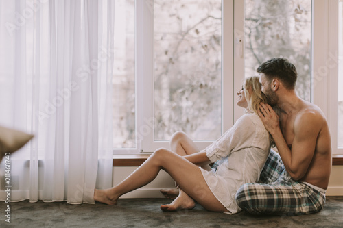 Loving couple sitting on the floor in the room