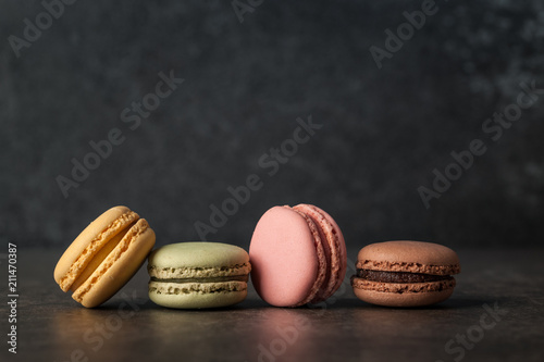 Poster Macarons French colorful macaroons on dark background