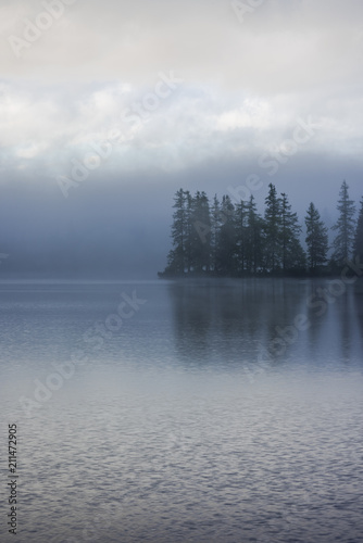Photo Stands Lavender Fogg over lake side and forest with water reflection