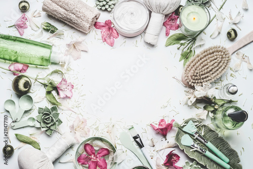 Keuken foto achterwand Spa Spa and wellness background with flowers, skin cosmetic products and others body care and massage accessories on white background, top view, frame with copy space