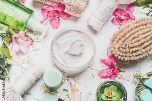 Fotografie, Obraz Skin cream with flowers petals and others body care cosmetic products and access