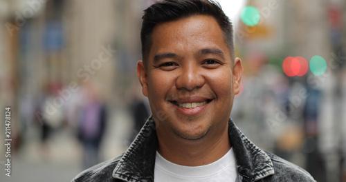 Foto  Asian man in city face portrait
