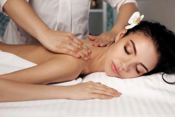 Obraz na płótnie Canvas Relaxed woman receiving massage