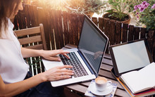 Young Woman With Laptop On Summer Balcony