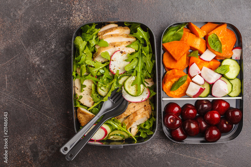 Keuken foto achterwand Assortiment Healthy meal prep containers with grilled chicken with salad, sweet potato, berries, fruits and vegetables. Dark background, top view.