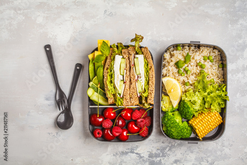 Poster Assortiment Healthy meal prep containers with feta sandwich with fruits, berries, rice and vegetables on white background, top view.