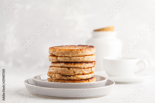 Homemade pancakes with chia seeds on a white plate, white background. Healthy vegan food concept.