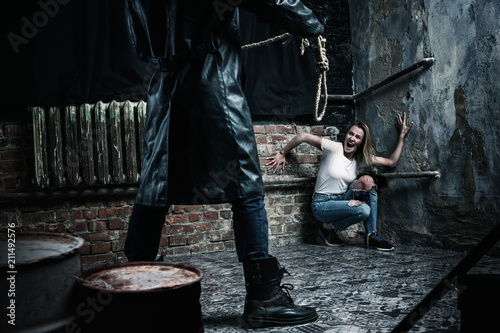 Maniac with rope prepares to strangle his victim Wallpaper Mural