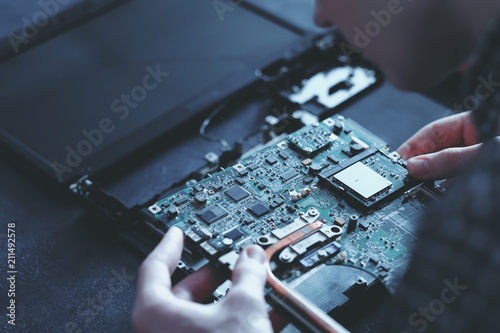 Obraz computer hardware development. microelectronics technology science concept. engineer holding modern motherboard - fototapety do salonu