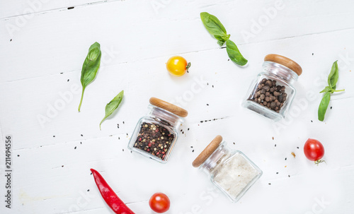 Spoed Foto op Canvas Kruiderij Herbs and spices in jars over on white wooden table. Ingredients for cooking