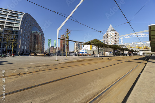 ROTTERDAM, 13 Marc 2016 - View of the tram station on the market place where the colorful Marthal building lays in front the cubic houses in Rotterdam, Netherlands