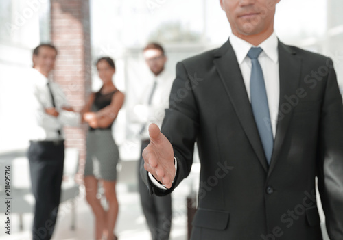 Fototapety, obrazy: successful businessman giving a hand