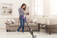 Young Woman Cleaning House Wit...