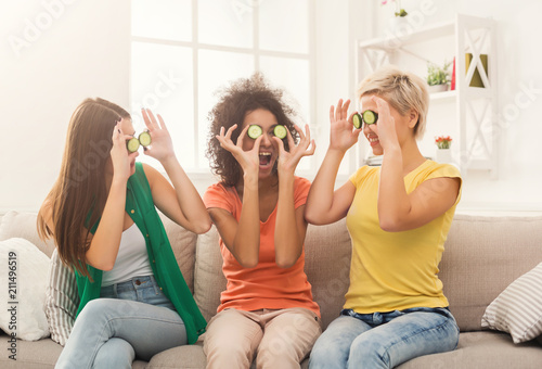 Fototapety, obrazy: Three beautiful girls covering eyes with cucumber