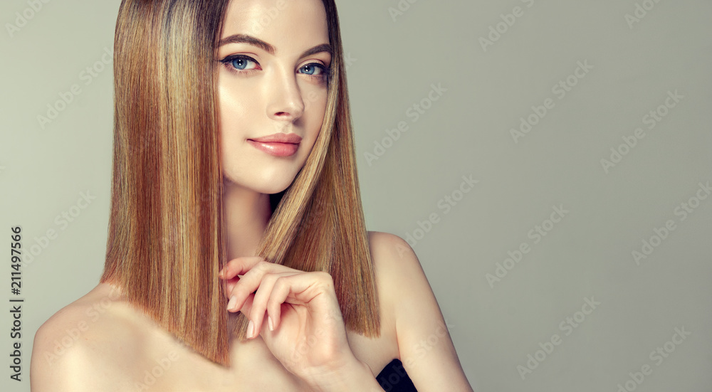 Fototapeta Beautiful model girl with shiny brown and straight long  hair .Keratin  straightening .Treatment, care and spa procedures.Medium length hairstyle. Coloring, ombre,and highlighting