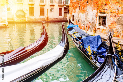 Canal with gondolas in Venice, Italy during sunrise. Tourism concept in Europe