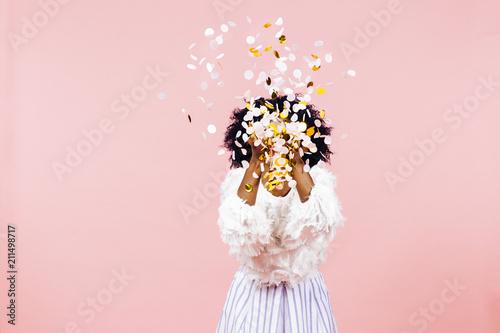 Obraz Woman throwing confetti in air - fototapety do salonu