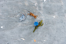 Blue Bottle Cap On The Beach In The Sand