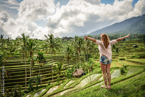 Wall Murals Bali Beautiful woman looking at tegallalang rice terrace
