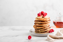 Stack Of Homemade Pancakes With Fresh Raspberries On Light Concrete Background, Copy Space