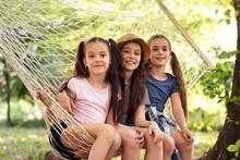 Little Girls In Hammock Outdoors. Summer Camp