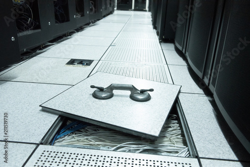 Lifted raised floor and suction tools in datacenter