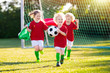 canvas print picture - Portugal football fan kids. Children play soccer.