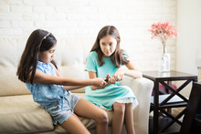 Two Children Fighting Over The Remote Control