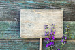 Wooden label with lavender flowers on rustic background