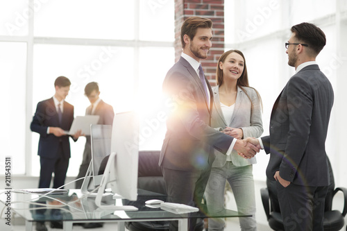 Photo  handshake business partners at a meeting