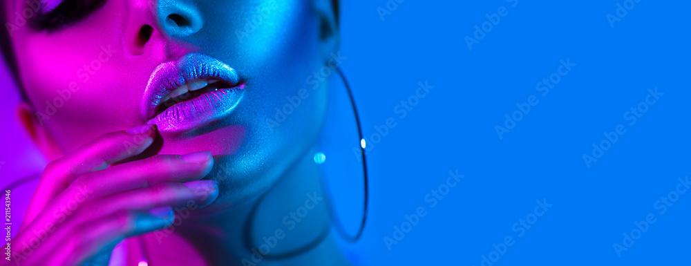 Fototapety, obrazy: High fashion model woman in colorful bright neon lights posing in studio. Beautiful sexy girl, trendy glowing makeup, metallic silver lips