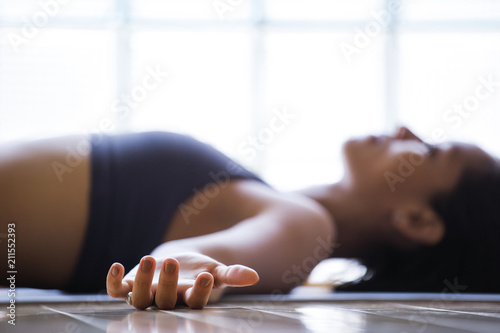 Fotografie, Obraz  Woman practicing yoga indoors.