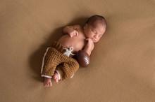 Newborn Baby Boy Wearing Footb...