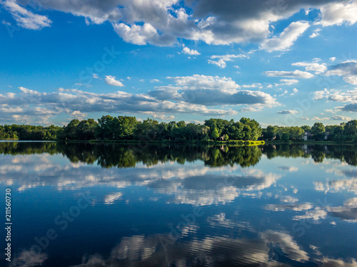 Foto op Aluminium Meer / Vijver Reflection of the cloudy sky in the water of little lake
