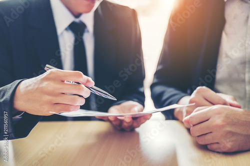 Fototapeta Business people Meeting negotiating a contract between two colleagues obraz