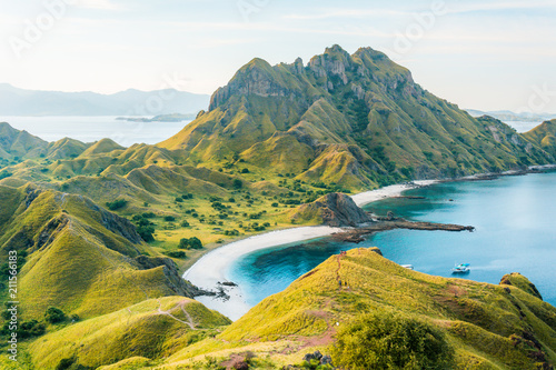 In de dag Khaki View of Padar Island in a cloudy evening with blue water surface and tourist boats, Komodo Island (Komodo National Park), Labuan Bajo, Flores, Indonesia