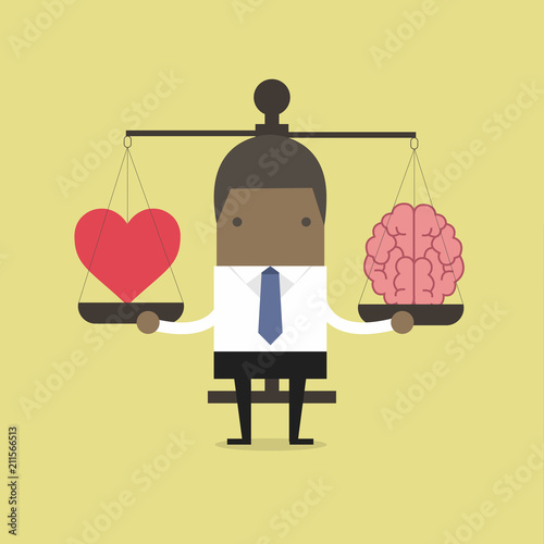 Photo African businessman with Heart and brain on scales.