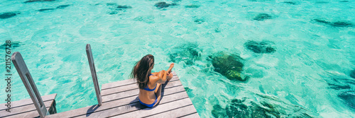 Fotografia  Luxury beach vacation travel destination woman relaxing on idyllic paradise blue turquoise clear water for snorkeling