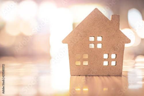 Photo Concept of hard paper house on floor , a symbol for construction , ecology, loan, mortgage, property or home