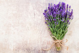 Fototapeta Lavender - Lavender flowers, bouquet on rustic background, overhead.