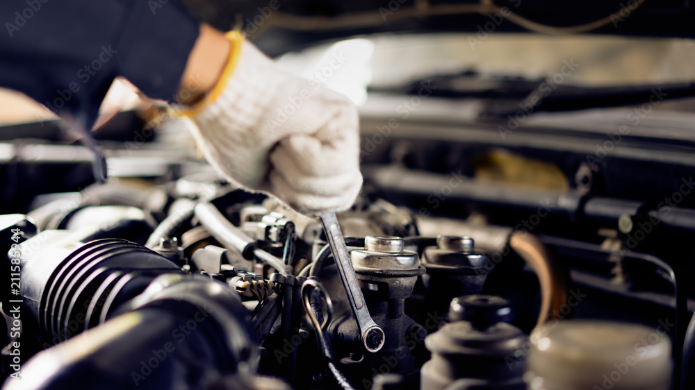 Fototapety, obrazy: Auto mechanic Preparing For the work. Mechanic with Stainless Steel Wrench in Hand.Close up of hands mechanic doing car service and maintenance.