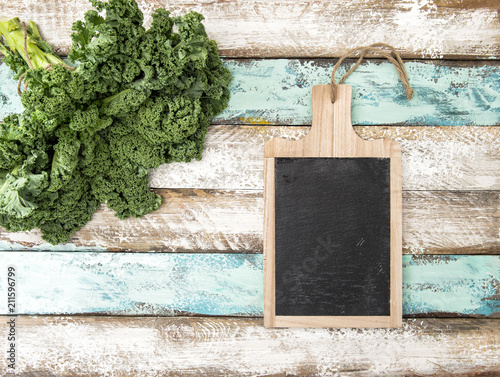 Keuken foto achterwand Aromatische Kale cabbage kitchen blackboard Green vegetable leaves