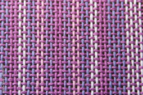 Fotografiet  woven fabric texture with ultraviolet and lilac colors