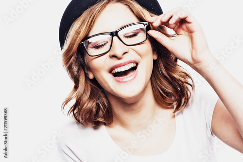 Papiers peints Echelle de hauteur Happy young student woman in fashion glasses and black hat on white background