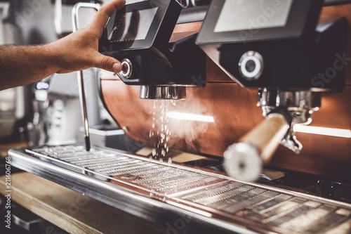Barista preparing professional coffee machine to work