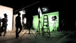 canvas print picture Behind the scenes of TV commercial movie film or video shooting production which crew team and camera man setting up green screen for chroma key technique in big studio.