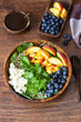 Summer spinach and fruit salad with seeds, mozzarella and balsamic vinegar in a bowl. Summer food concept