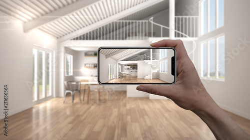 Photo Hand holding smart phone, AR application, simulate furniture and interior design