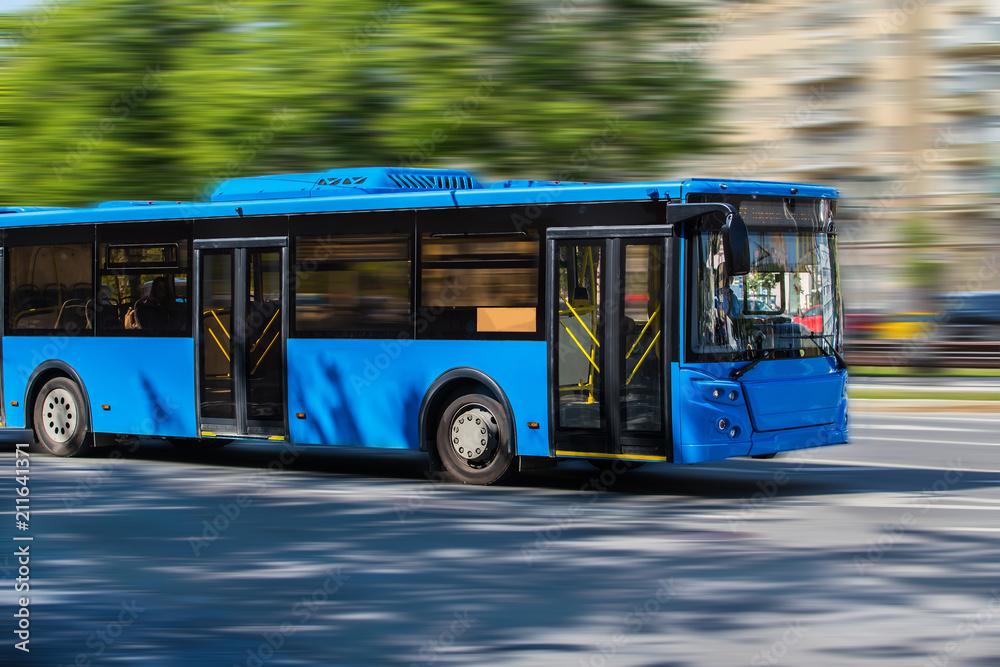 Fototapeta city bus goes along street