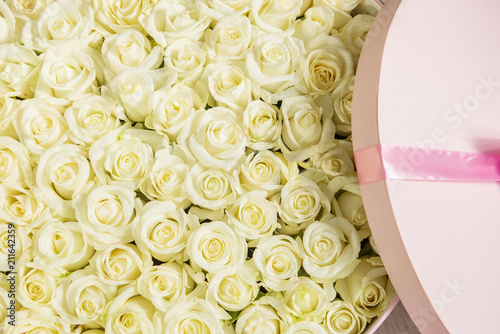 Round large box with white roses wrapped in roses